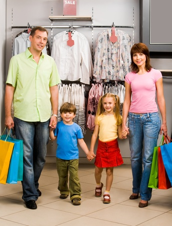 Portrait of family walking down shopping mall after good shopping Stock Photo - 8507915