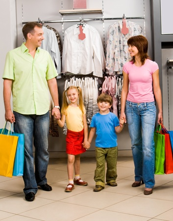 Portrait of family in clothing department of trade center Stock Photo - 8507902