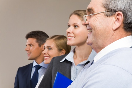 Image of business group standing in line and looking forward with senior leader in focus Stock Photo - 8506827