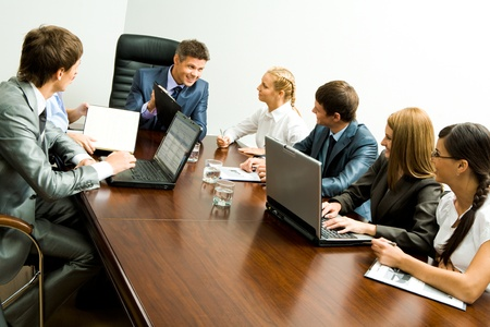 briefing: Portrait of confident team planning work and interacting with each other at briefing Stock Photo