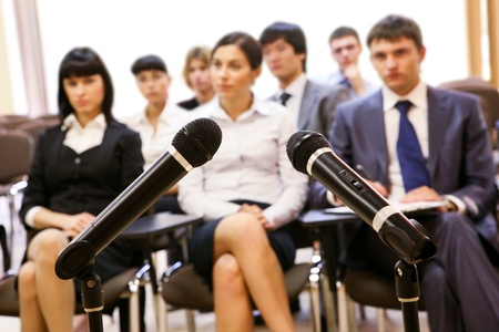 Image of confident people listening to lecture at conference photo