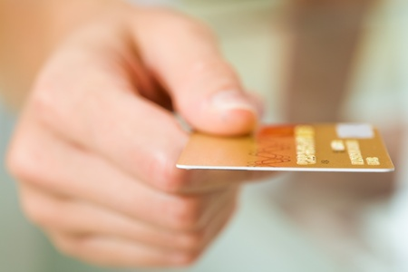 charge card: Macro image of plastic card in human hand