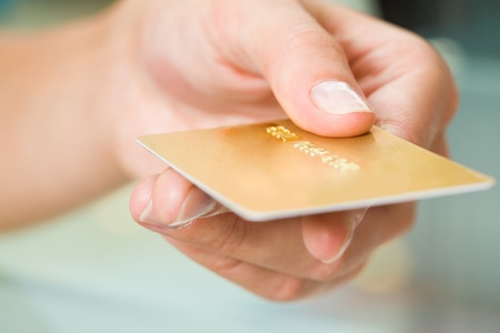 Macro image of plastic card in human hand photo