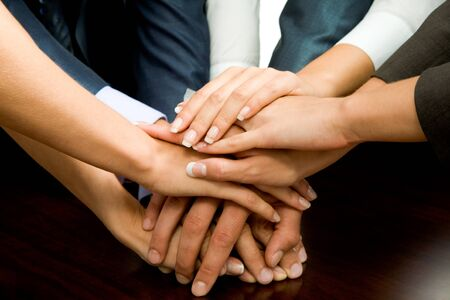 together concept: Close-up of business people's hands on top of each other  Stock Photo