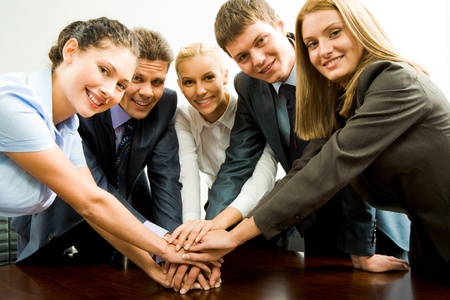 support team: Portrait of happy business team keeping their hands on top of each other  Stock Photo