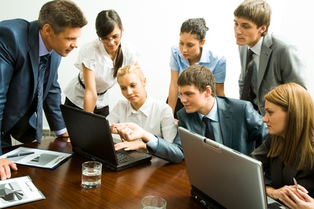 Image of company of successful partners looking at laptop monitor Stock Photo - 8508170