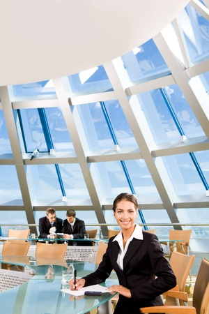 Confident woman sitting in the conference room and smiling photo