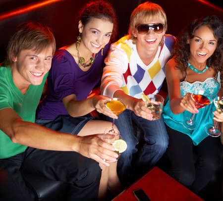Portrait of young people with flutes looking at you while in the nightclub Stock Photo - 8508211