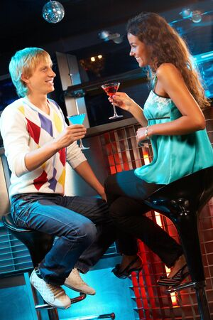 Portrait of attractive couple chatting in the bar  photo