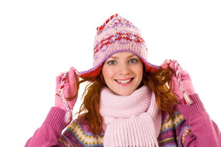 Image of pretty woman in pink winter cap posing before camera photo