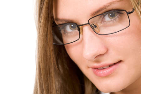 Close-up of charming woman in eyeglasses looking at camera Stock Photo - 8508055