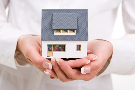 Close-up of toy house model in female hands Stock Photo - 8508219