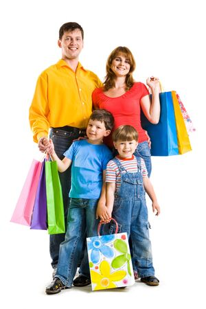 shopaholics: Photo of friendly parents and siblings with bags isolated over white background Stock Photo