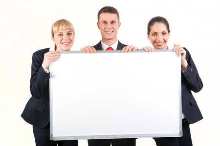 whiteboard: Portrait of confident business people holding whiteboard and looking at camera