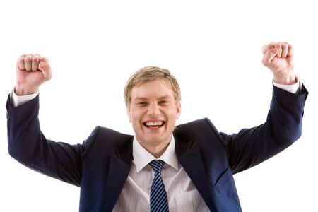 Portrait of lucky winner showing his happiness by keeping arms raised photo