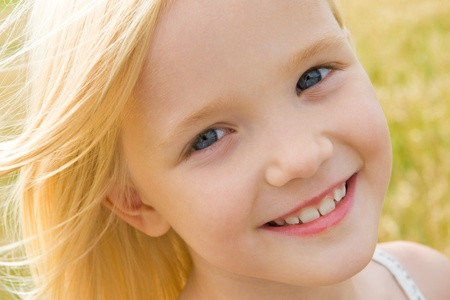 innocence: Face of youthful girl looking at camera with smile Stock Photo