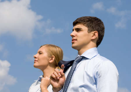 Portrait of confident business partners looking forward against blue sky Stock Photo - 8508215