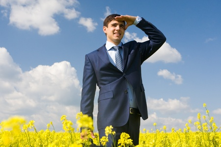 ceo: Portrait of successful male looking forward in yellow meadow