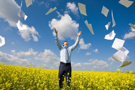 Image of happy winner throwing papers in yellow meadow Stock Photo - 8508147