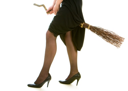 antichrist: Image of female legs in black tights and black clothing riding on broom