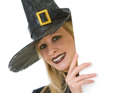 Halloween witch looking out of board with your advert Stock Photo - 8522412