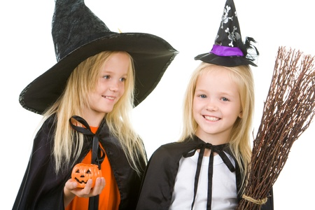 antichrist: Portrait of girl twins in black hats and black clothing Stock Photo