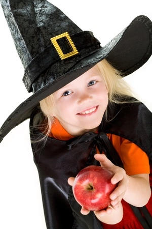 antichrist: Portrait of girl in witch costume and red apple in hands