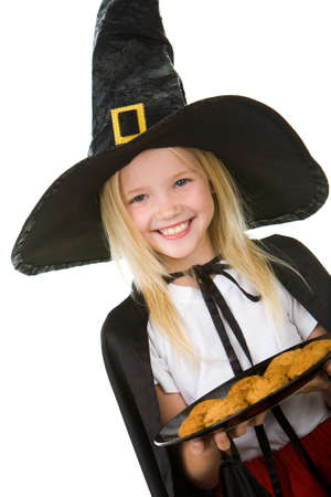 cute halloween: Girl in halloween costume holding tray with bisquits