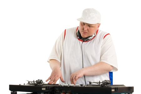 Portrait of smart deejay spinning turntable photo