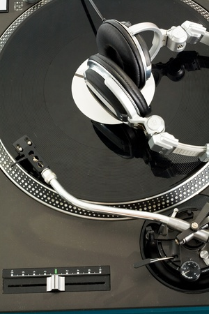Close-up of vynil turntable with headphones on it photo