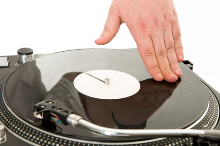 Close-up of human hand spinning vynil turntable photo