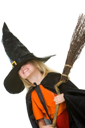 repent: Photo of girl in halloween costume holding broom Stock Photo