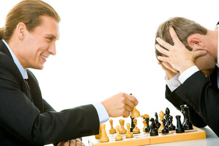 Image of businessmen playing in chess photo