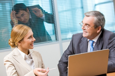 Portrait of executive employees looking at each other and communicating in office Stock Photo - 9455198