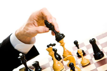 Image of human hand holding chess photo
