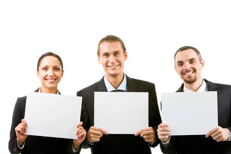 Row of happy business partners holding blank papers and looking at camera photo