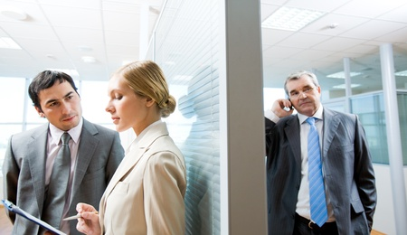 Portrait of serious business partners interacting in office Stock Photo - 9455213