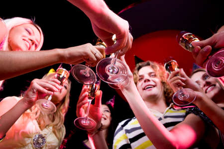 Bottom view of people clinking glasses with each other Stock Photo - 8523993