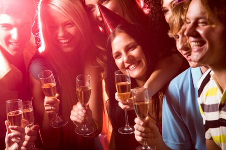 new years eve: Photo of happy student with beverages during birthday  Stock Photo