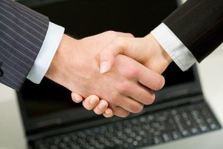 striking: Handshake of business partners after striking deal