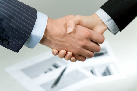 negotiation business: Photo of handshake of business partners after signing promising contract  Stock Photo