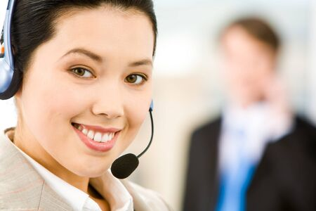 Face of attractive Customer Support Representative with a smile Stock Photo - 8524861