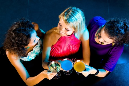 Above angle of happy girls cheering up at party  Stock Photo - 8549109