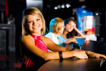 Portrait of happy girl looking at camera in the bar Stock Photo - 8524146