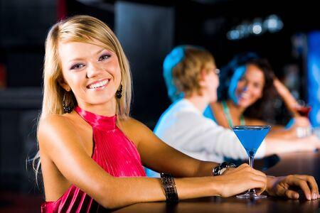 Portrait of happy girl in the bar with other people on background Stock Photo - 8525052