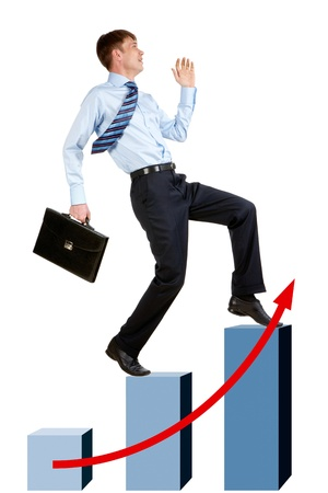 Image of happy businessman running upstairs on chart column tops photo
