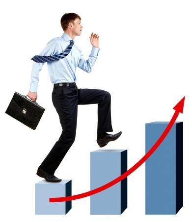 Image of happy businessman running upwards on chart column tops Stock Photo - 8522288