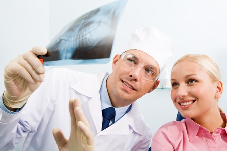 Image of young lady with dentist showing her x-ray scanned image Stock Photo - 8524822