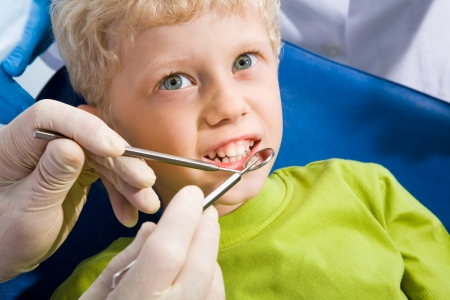 Little boy before mouth checkup in dental clinic Stock Photo - 8525129