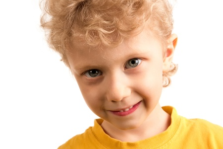Portrait of smiling boy looking at camera over white background Stock Photo - 8524827